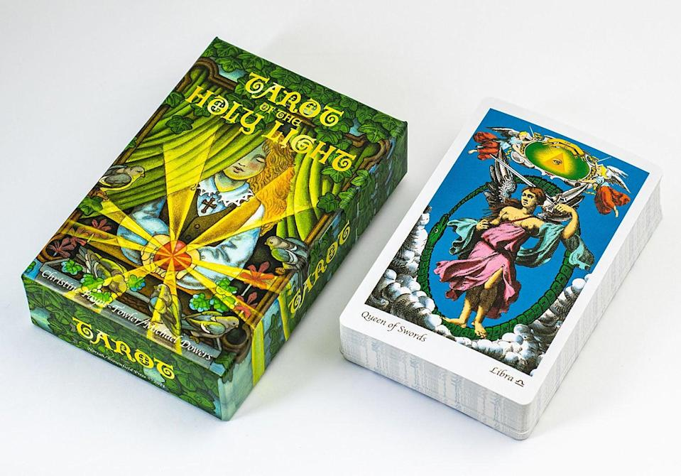 "<h2>Tarot of the Holy Light Deck</h2><br>Grazda also recommends the Tarot of the Holy Light Deck for users. ""This deck will especially appeal to fans of alchemical symbolism, but is eye-catching enough to grab just about anyone's attention,"" she says. Grazda says that while some of the symbols cards are unconventional, they still ""<a href=""https://www.refinery29.com/en-gb/2020/09/10014057/virtual-spiritual-wellness-review"" rel=""nofollow noopener"" target=""_blank"" data-ylk=""slk:inspire further self-reflection"" class=""link rapid-noclick-resp"">inspire further self-reflection</a>, and are worth testing out.""<br><br><strong>Brownfield Press</strong> Tarot Deck, $, available at <a href=""https://go.skimresources.com/?id=30283X879131&url=https%3A%2F%2Fnoreahbrownfield.com%2Fproduct%2Ftarot-holy-light-tarot-deck-deluxe-size-edition%2F"" rel=""nofollow noopener"" target=""_blank"" data-ylk=""slk:Noreah Brownfield"" class=""link rapid-noclick-resp"">Noreah Brownfield</a>"