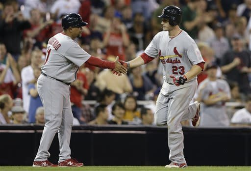 St. Louis Cardinals' David Freese, right, is congratulated by third base coach Jose Oquendo after Freese hit a home run during the seventh inning of their baseball game againt the San Diego Padres Tuesday, Sept. 11, 2012, in San Diego. (AP Photo/Gregory Bull)