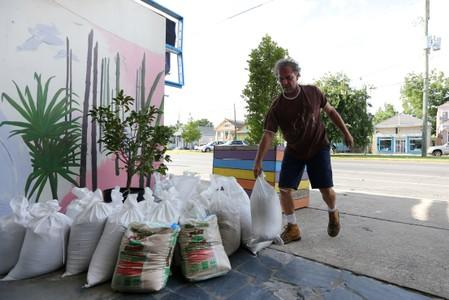 Herman Krom sets sandbags in front of his business as Tropical Storm Barry approaches land in New Orleans