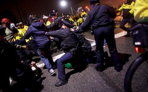 Police clash with fans celebrating the Philadelphia Superbowl LII victory over the New England Patriots - Credit: Reuters