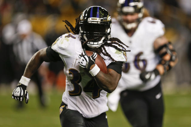 "Baltimore Ravens running back <a class=""link rapid-noclick-resp"" href=""/nfl/players/29405/"" data-ylk=""slk:Alex Collins"">Alex Collins</a> has the potential to outperform his ADP behind a revamped offensive line. (AP Photo/Keith Srakocic)"