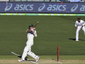 Australia's Joe Burns, left, his a 6 to win their cricket test match against India on the third day at the Adelaide Oval in Adelaide, Australia, Saturday, Dec. 19, 2020. (AP Photo/David Mariuz)
