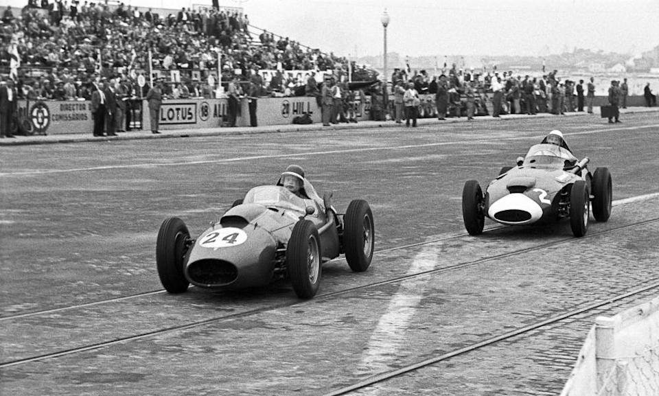 Mike Hawthorn leads Stirling Moss over cobblestones and tram tracks in Boavista.