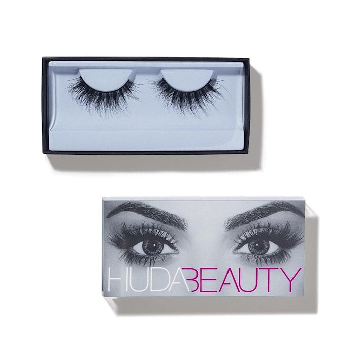 Why you'll love it: These volumizing false lashes actually look natural. They are double-stacked with varying lengths for a feathery look, and the inner and outer corners are tapered, giving a more natural appearance compared to lashes that are all the same length. The fibers fan out just enough to show off any eye shadow you may be wearing. How you'll use it: In terms of wearability, these are comfortable. The band is thin enough to easily blend in with eyeliner, and doesn't feel heavy on lids. Check out our guide to applying lashes here. +Subscribe now+