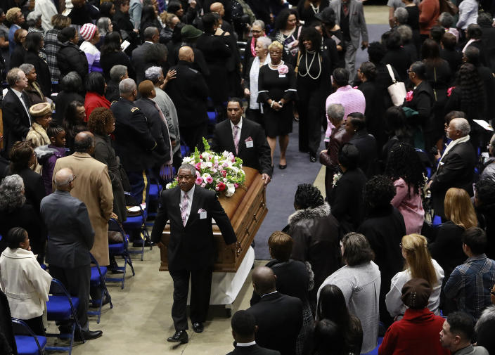 """The casket of Katherine Johnson departs Hampton University Convocation Center at the conclusion of a memorial service on Saturday, March 7, 2020, at Hampton University Convocation Center in Hampton, Va. Johnson, a mathematician who calculated rocket trajectories and earth orbits for NASA's early space missions and was later portrayed in the 2016 hit film """"Hidden Figures,"""" about pioneering black female aerospace workers died on Monday, Feb. 24, 2020. She was 101. (Kaitlin McKeown /The Virginian-Pilot via AP)"""