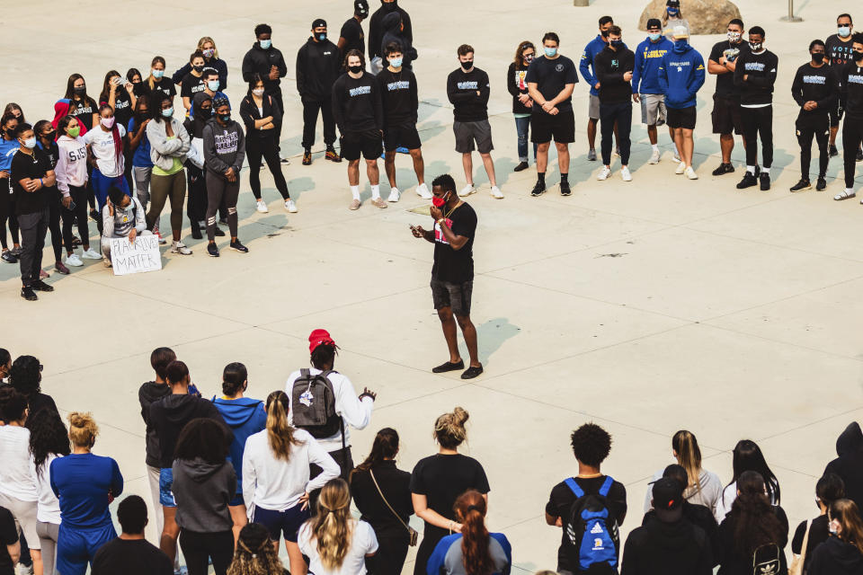 In this Sept. 1, 2020 photo, San Jose State University football player Christian Webb delivers the keynote address at a protest against racial injustice in San Jose, Calif. Student-athletes across college campuses are taking a lead from professional athletes by using their platforms in hopes of creating change. (Aubrey Tibbils, San Jose State University Athletics via AP)