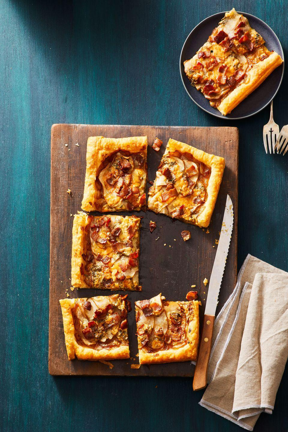 "<p>Wow your crew with this sweet and savory treat that's secretly simple to make.</p><p><em><a href=""https://www.goodhousekeeping.com/food-recipes/a30434015/pear-blue-cheese-tart-recipe/"" rel=""nofollow noopener"" target=""_blank"" data-ylk=""slk:Get the recipe for Pear, Bacon and Blue Cheese Tart »"" class=""link rapid-noclick-resp"">Get the recipe for Pear, Bacon and Blue Cheese Tart »</a></em></p>"