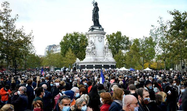 France terror attack: Thousands gather in Paris to honour murdered teacher