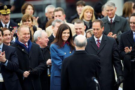 Pennsylvania Attorney General Kathleen Kane congratulates Governor Tom Wolf following his inauguration ceremony at the State Capitol in Harrisburg, PA on January 20, 2015.