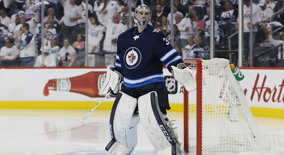 "<a class=""link rapid-noclick-resp"" href=""/nhl/players/5820/"" data-ylk=""slk:Connor Hellebuyck"">Connor Hellebuyck</a> just made himself some serious coin. (Jason Halstead/Getty Images)"