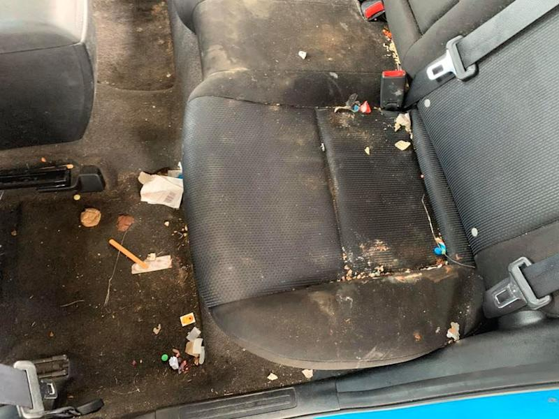 Rubbish, dirt and food scraps covered the carpet and the seats in the back of the car. Source: Proline Automotive