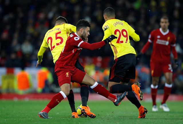 "Soccer Football - Premier League - Liverpool vs Watford - Anfield, Liverpool, Britain - March 17, 2018 Liverpool's Alex Oxlade-Chamberlain in action with Watford's Jose Holebas and Etienne Capoue REUTERS/Phil Noble EDITORIAL USE ONLY. No use with unauthorized audio, video, data, fixture lists, club/league logos or ""live"" services. Online in-match use limited to 75 images, no video emulation. No use in betting, games or single club/league/player publications. Please contact your account representative for further details."