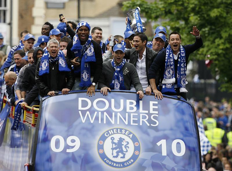 Chelsea's Captain John Terry (R), English midfielder Frank Lampard (2ndR), Czech goalkeeper Petr Cech (C) and Ivory Coast striker Didier Drogba (L) show off the Barclays Premiership Trophy and FA Cup during their victory parade at Stamford Bridge, London, England, on May 16, 2010. Didier Drogba insists Chelsea's Premier League and FA Cup double triumph means this season has been the best of his career. Drogba scored the only goal of the game in the FA Cup final against Portsmouth to secure a first ever double for the west London club. AFP PHOTO/GLYN KIRK (Photo credit should read GLYN KIRK/AFP/Getty Images)