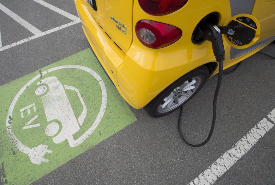 "<span class=""caption"">Canada's climate plan includes adding more electric vehicle charging stations, improving energy efficiency of homes and buildings, and raising the price on carbon to $170 per tonne by 2030.</span> <span class=""attribution""><span class=""source"">THE CANADIAN PRESS/Jonathan Hayward</span></span>"