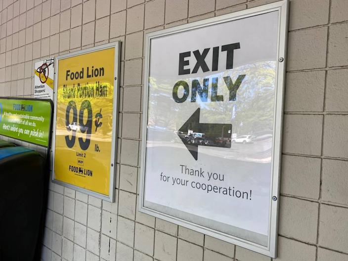 Signs at a Food Lion grocery store on Wycliff Avenue in Raleigh, NC, on Tuesday, April 14, mark dedicated entrances and exits. The one-way entrances and exits were encouraged in a new Executive Order from Gov. Roy Cooper, intended to slow the transmission of COVID-19.