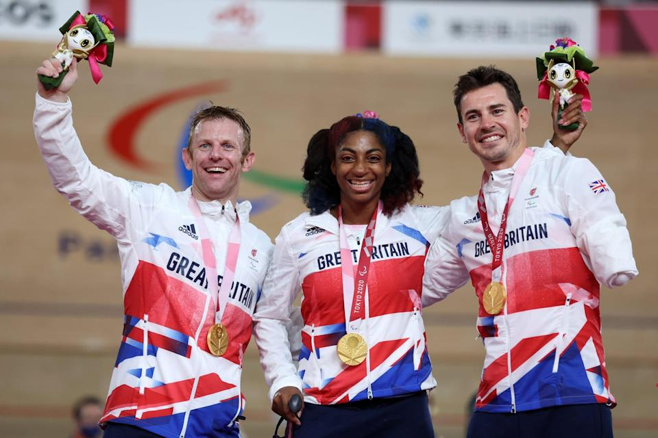 IZU, JAPAN - AUGUST 28: (L-R) Jody Cundy, Kadeena Cox and Jaco van Gass of Team Great Britain react after winning the gold medal in the Mixed C1-5 750m Team Sprint track cycling on day 4 of the Tokyo 2020 Paralympic Games at Izu Velodrome on August 28, 2021 in Izu, Japan. (Photo by Kiyoshi Ota/Getty Images)