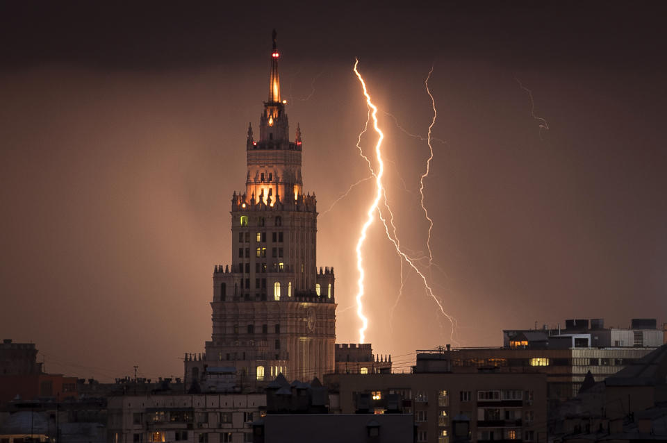 A lightning bolt striking a Stalin era skyscraper during a storm over Moscow