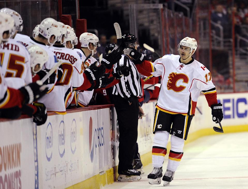 Calgary Flames left wing Lance Bouma (17) celebrates his goal against the Washington Capitals during the first period of an NHL hockey game, Tuesday, Nov. 4, 2014, in Washington. (AP Photo/Nick Wass)