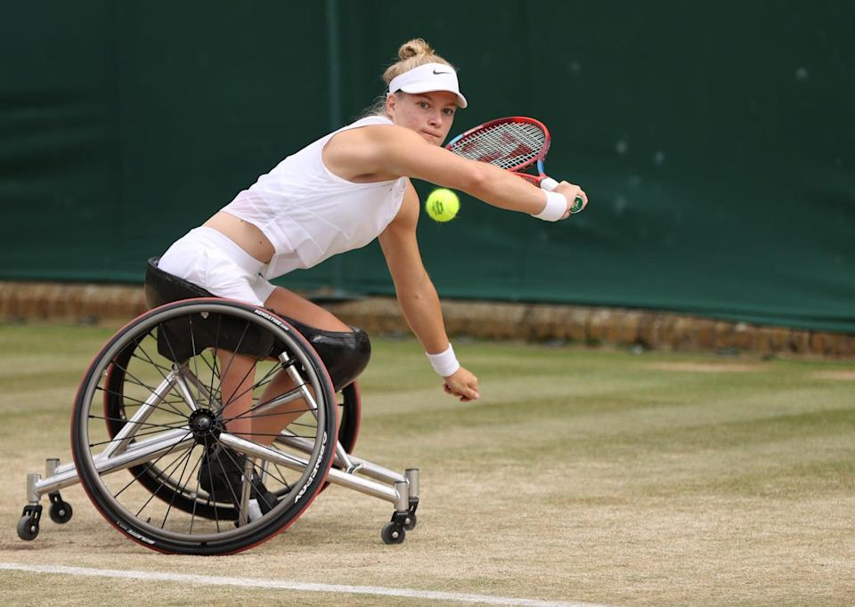 LONDON, ENGLAND - JULY 08: Diede De Groot of The Netherlands stretches to play a backhand in her Ladies' Wheelchair Singles Quarter-Final match against Lucy Shuker of Great Britain on Day Ten of The Championships - Wimbledon 2021 at All England Lawn Tennis and Croquet Club on July 08, 2021 in London, England. (Photo by Clive Brunskill/Getty Images)