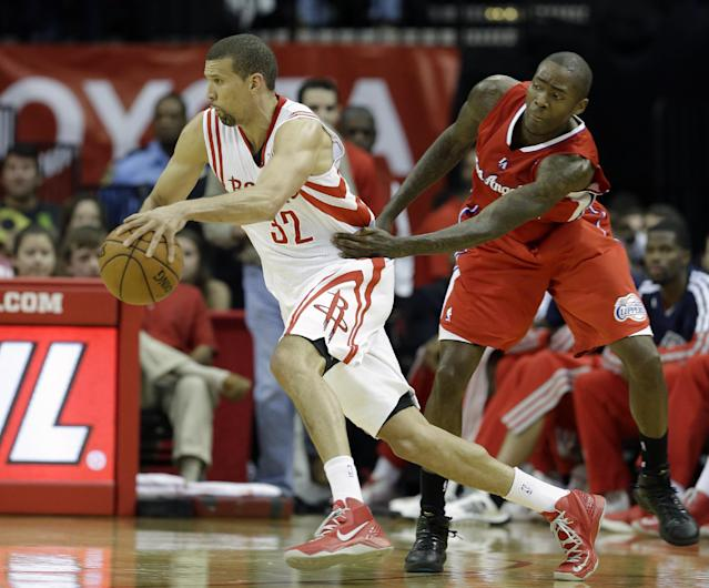 Houston Rockets' Francisco Garcia (32) is grabbed by Los Angeles Clippers' Jamal Crawford, right, in the first half of an NBA basketball game on Saturday, Nov. 9, 2013, in Houston. (AP Photo/Pat Sullivan)