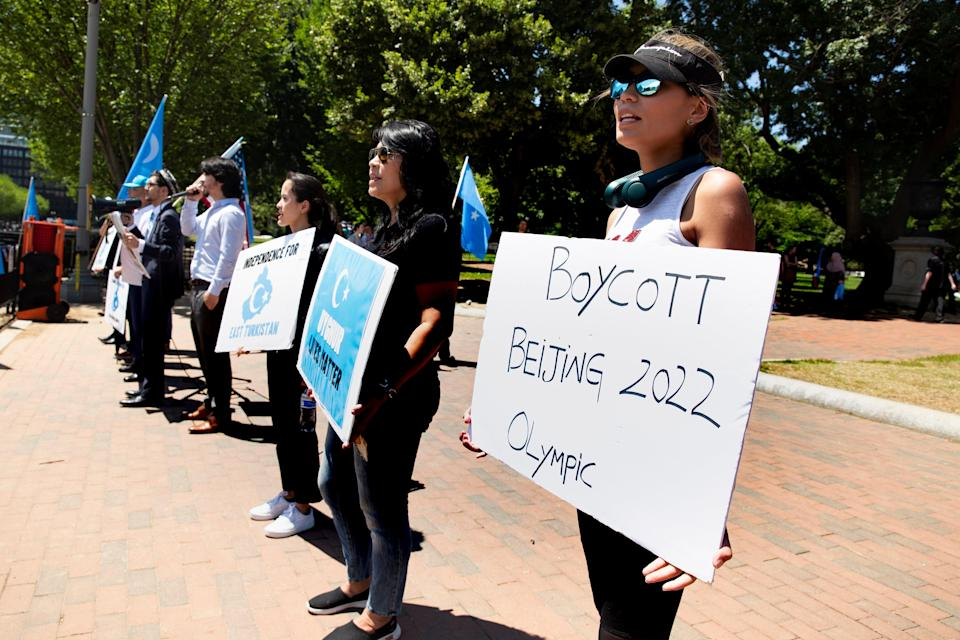 <p>File image: Activists who support independence from China for the Xinjiang Uighur Autonomous Region, which they refer to as 'East Turkestan', gather in Lafayette Square across the street from the White House on 4 June 2021</p> (EPA)