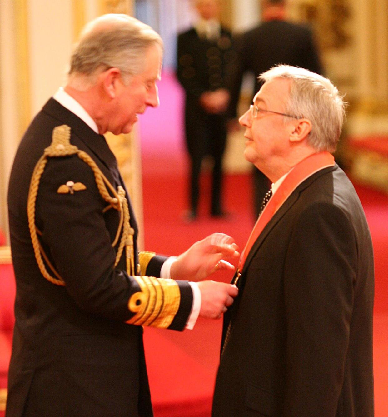Graham Vick, artistic director of the Birmingham Opera Company, receives his CBE from the Prince of Wales during investitures at Buckingham Palace in London.