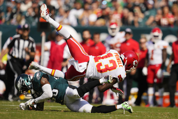 Kansas City Chiefs wide receiver Byron Pringle (13) is tackled by Philadelphia Eagles free safety Rodney McLeod (23) during the first half of an NFL football game Sunday, Oct. 3, 2021, in Philadelphia. (AP Photo/Matt Slocum)