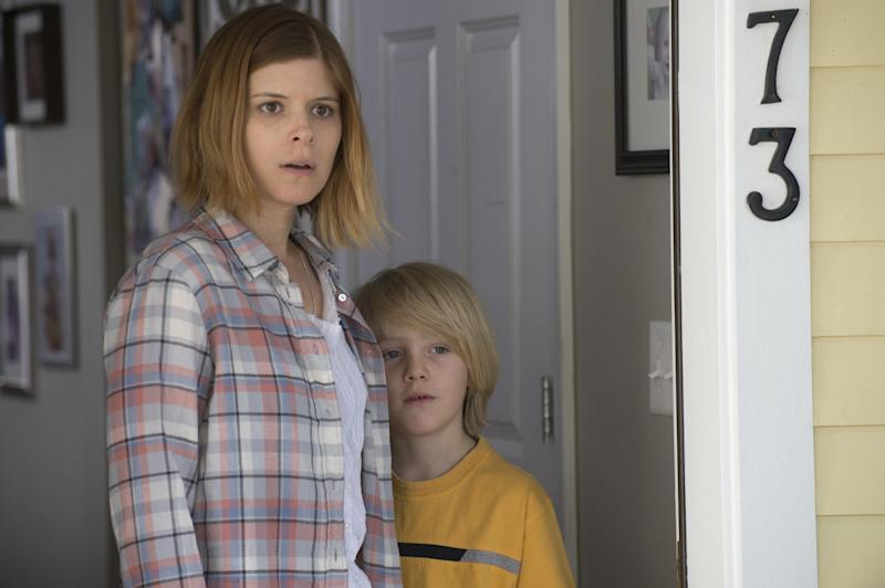 "This image released by Lionsgate shows Kate Mara, left, and Charlie Shotwell in a scene from, ""Man Down."" (Lionsgate via AP)"