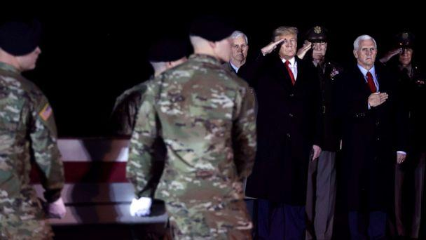 PHOTO: President Donald Trump and Vice President Mike Pence attend a dignified transfer of the remain of Special Forces soldier Sgt. 1st Class Javier Gutierrez, at Dover Air Force Base in Dover, Del. Feb. 10, 2020. (Jonathan Ernst/Reuters)
