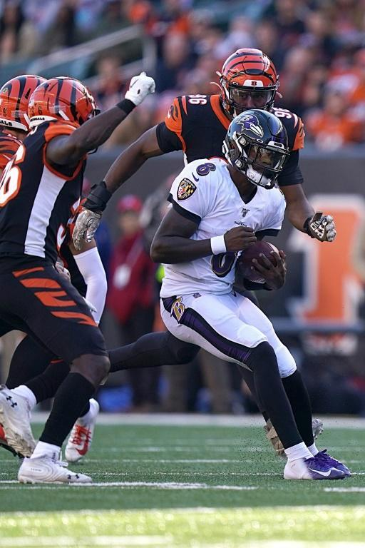 Baltimore quarterback Lamar Jackson runs with the ball during the Ravens' NFL victory over the Cincinnati Bengals (AFP Photo/Bryan Woolston)