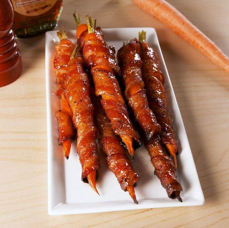 "<p>Sweet, savory, rich, and tender.</p><p>Get the recipe from <a href=""https://www.delish.com/cooking/a19625150/maple-bacon-carrots-recipe/"" rel=""nofollow noopener"" target=""_blank"" data-ylk=""slk:Delish"" class=""link rapid-noclick-resp"">Delish</a>.</p>"