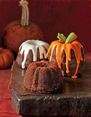 """<p>To make this nifty pumpkin cake, just flip a mini-bundt cake upside down, place another on top, and glaze with orange icing. For extra effect, add a marzipan stem.</p><p><strong><a href=""""https://www.countryliving.com/diy-crafts/a2441/mini-pumpkin-cakes-1008/"""" rel=""""nofollow noopener"""" target=""""_blank"""" data-ylk=""""slk:Get the recipe"""" class=""""link rapid-noclick-resp"""">Get the recipe</a>.</strong> </p>"""