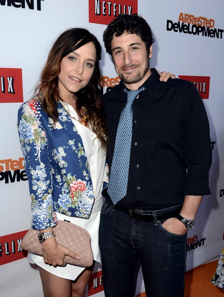 "LOS ANGELES, CA - APRIL 29:  Actor Jason Biggs (R) and his wife Jenny Mollen arrive at the premiere of Netflix's ""Arrested Development"" Season 4 at the Chinese Theatre on April 29, 2013 in Los Angeles, California.  (Photo by Kevin Winter/Getty Images)"