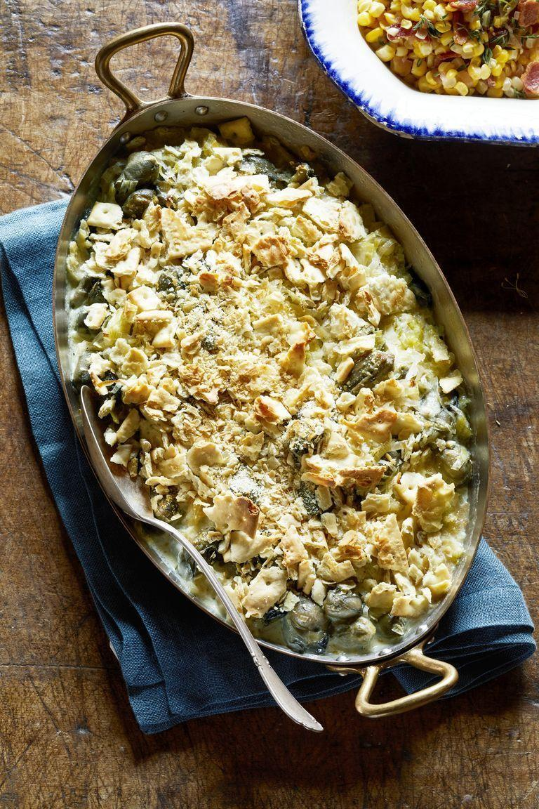 "<p>The trick to keeping this deliciously creamy dish at its best: Put the crushed saltine topping on right before serving. </p><p><strong><a href=""https://www.countryliving.com/food-drinks/a29132365/scalloped-oysters-recipe/"" rel=""nofollow noopener"" target=""_blank"" data-ylk=""slk:Get the recipe"" class=""link rapid-noclick-resp"">Get the recipe</a>.</strong></p><p><a class=""link rapid-noclick-resp"" href=""https://www.amazon.com/Lodge-Casserole-Enamel-Handles-Carribbean/dp/B000N4UX4Q?tag=syn-yahoo-20&ascsubtag=%5Bartid%7C10050.g.34554232%5Bsrc%7Cyahoo-us"" rel=""nofollow noopener"" target=""_blank"" data-ylk=""slk:SHOP CASSEROLE PANS"">SHOP CASSEROLE PANS</a></p>"