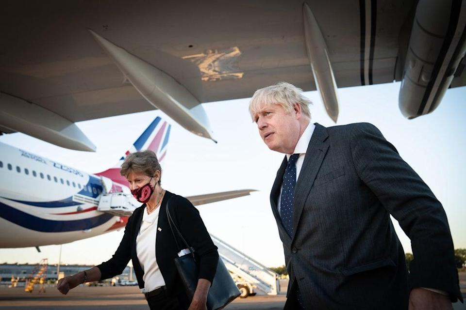 Boris Johnson with Dame Barbara Janet Woodward, Permanent Representative of the United Kingdom to the United Nations, as he landed in New York's JFK airport (PA)