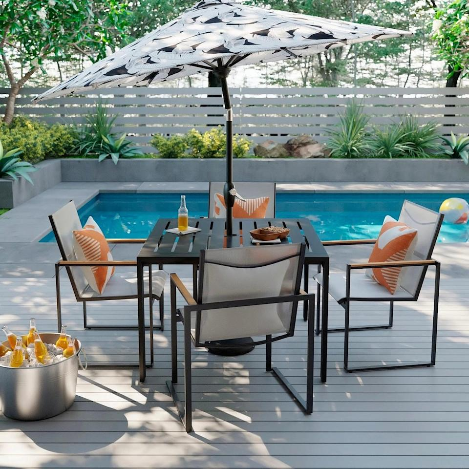 <p>The chic design of the <span>Henning Two-Pack Patio Dining Chair</span> ($180) accompanies any preexisting black furnishings flawlessly, with a refreshing, bright twist.</p>