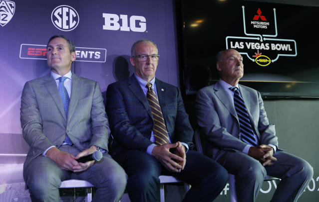 From left, Pac-12 Commissioner Larry Scott, SEC Commissioner Greg Sankey and Big Ten Commissioner Jim Delany attend a news conference to announce changes to the Las Vegas Bowl football game, Tuesday, June 4, 2019, in Las Vegas. The Las Vegas Bowl is moving to a new, bigger stadium next year, and will feature teams from the SEC or Big Ten conferences against a Pac-12 contender. (AP Photo/John Locher)