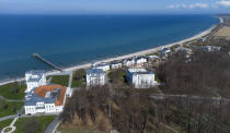 The beach promenade close to the 'MEDIAN Clinic Heiligendamm' is pictured in Heiligendamm, northern Germany, Wednesday, April 14, 2021. The MEDIAN Clinic, specialized on lung diseases, treats COVID-19 long time patients from all over Germany. (AP Photo/Michael Sohn)