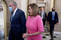 Senate Minority Leader Sen. Chuck Schumer of N.Y., left, and House Speaker Nancy Pelosi of Calif., right, walk out of a meeting with Treasury Secretary Steven Mnuchin and White House Chief of Staff Mark Meadows as they continue to negotiate a coronavirus relief package on Capitol Hill in Washington, Friday, Aug. 7, 2020. (AP Photo/Andrew Harnik)