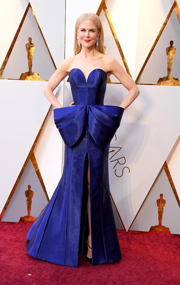 <p>Nicole Kidman wows fans in a blue strapless gown designed by Armani Privè. This dress has gone viral online and is by far the best dressed of the night.</p>