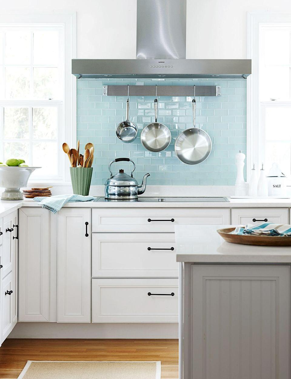 <p>Thanks to high-gloss blue tiles, this compact kitchen is filled with style and personality. </p>