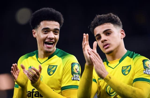 Jamal Lewis (left) and Max Aarons applaud the Norwich crowd after the victory (Joe Giddens/PA)