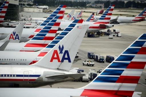 American Airlines defends pay increase as shares tumble