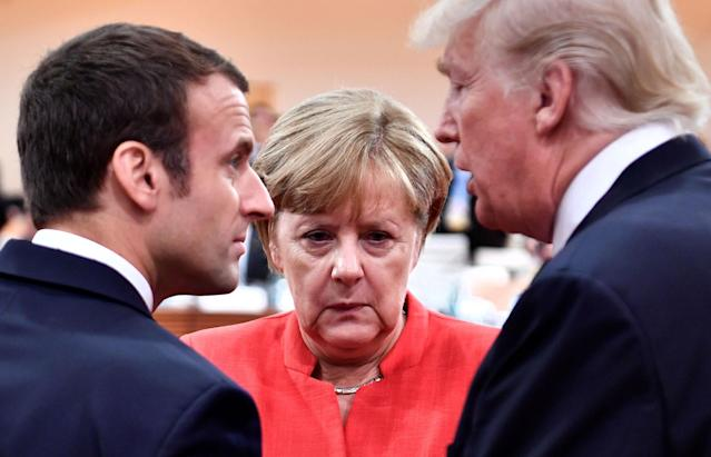 <p>French President Emmanuel Macron, German Chancellor Angela Merkel and President Donald Trump confer at the start of the first working session of the G20 meeting in Hamburg, Germany, July 7, 2017. (Photo: John MacDougall/Pool/Reuters) </p>