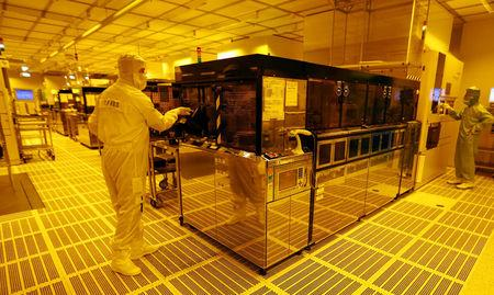 FILE PHOTO: An employee is pictured inside a clean room of German semiconductor manufacturer Infineon in Regensburg
