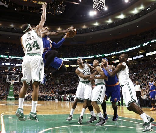 New York Knicks' J.R. Smith (8) drives to the basket past Boston Celtics' Paul Pierce (34) as Jordan Crawford, right, Avery Bradley, and Jeff Green, left, fight Knicks' Carmelo Anthony for position during the second quarter of a, NBA basketball game in Boston, Tuesday, March 26, 2013. (AP Photo/Winslow Townson)