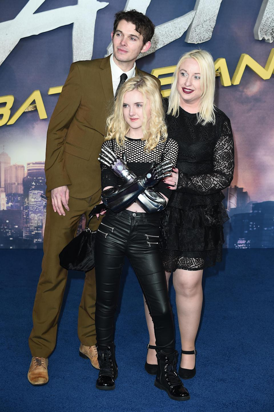 Tilly with her new bionic arms at the U.K. premiere of Alita: Battle Angel. Photo: Getty