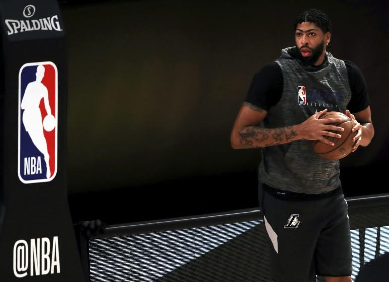 Los Angeles Lakes' Anthony Davis warms up prior to an NBA basketball game against the Los Angeles Clippers.