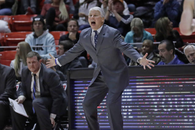 UC Davis coach Jim Les reacts to a call during the second half of the team's NCAA college basketball game against Utah on Friday, Nov. 29, 2019, in Salt Lake City. (AP Photo/Rick Bowmer)