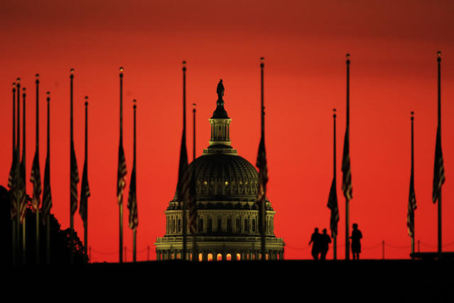 The U.S. Capitol dome is the backdrop for flags lowered to half-staff in honor of the victims killed in the Las Vegas shooting as the sun rises on Oct. 3, 2017, at the foot of the Washington Monument on the National Mall in Washington. (Photo: Manuel Balce Ceneta/AP)